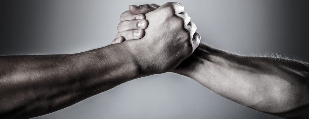 Two hands holding on a black and white background