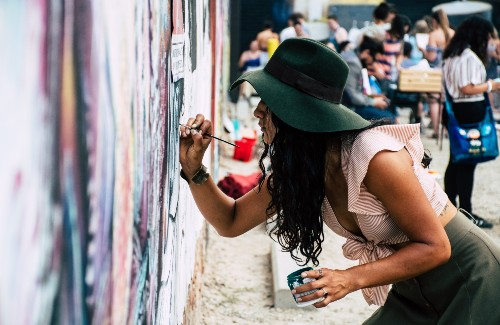 woman with hat on painting on wall