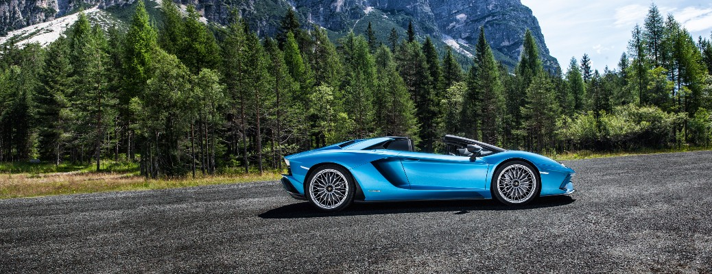 2020 Lamborghini Aventador S Roadster blue parked on asphalt in front of trees