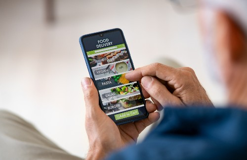 person ordering food for delivery off of their smartphone