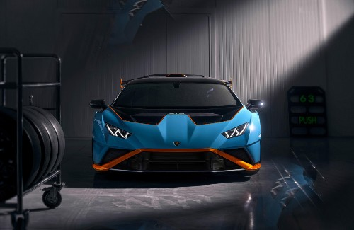 2021 lamborghini huracan sto exterior front fascia parked in garage with stack of tires