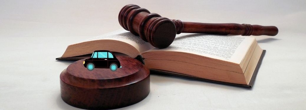gavel law book and cartoon car