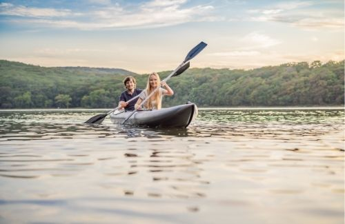 couple in a double kayak on a lake