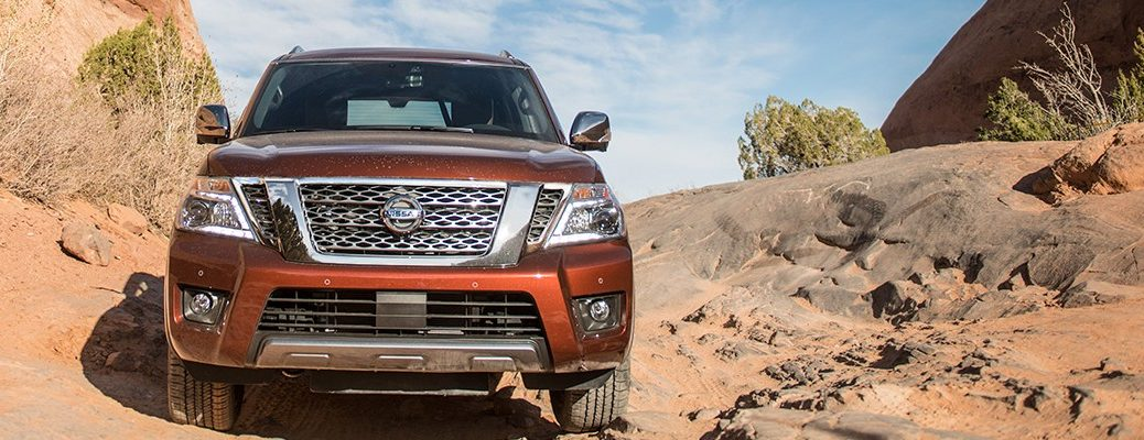 Front view of 2019 Nissan Armada driving through desert landscape