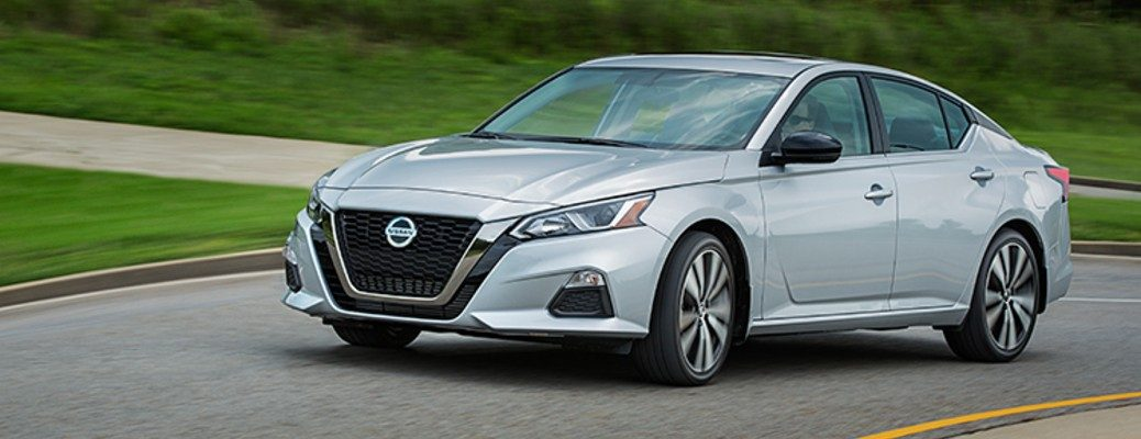 Silver 2020 Nissan Altima driving on residential road