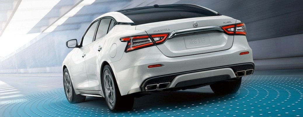 Stylized rear image of white 2019 Nissan Maxima driving through tunnel