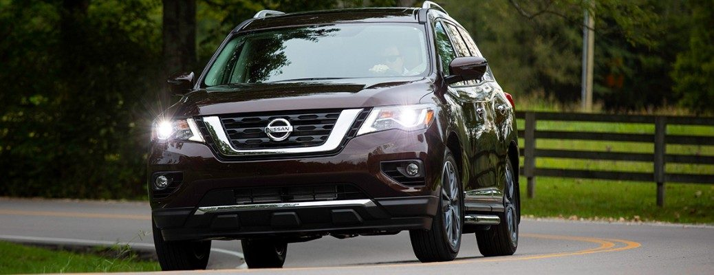 Front view of 2019 Nissan Pathfinder driving on residential road
