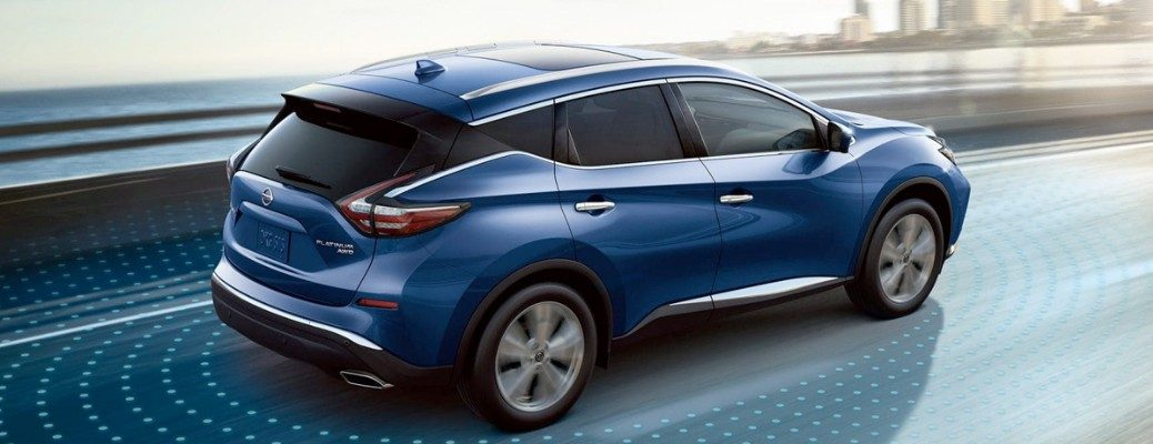 Blue Nissan Murano driving on highway