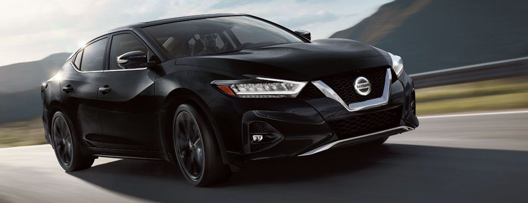 Black 2020 Nissan Maxima driving on empty highway