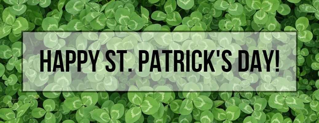 Happy St. Patrick's Day banner with clovers in the background