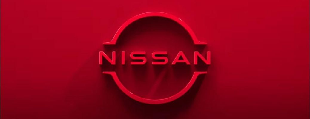 New Nissan Logo against a red background