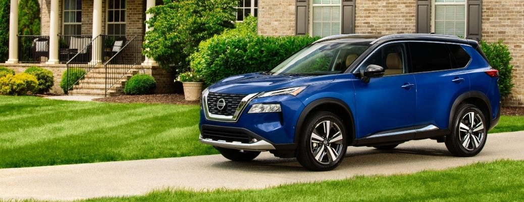 Exterior view of a blue 2021 Nissan Rogue
