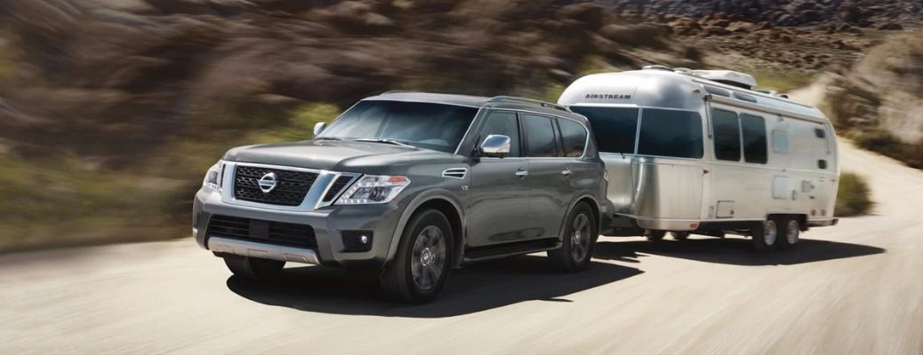 Exterior view of a gray 2020 Nissan Armada towing a trailer