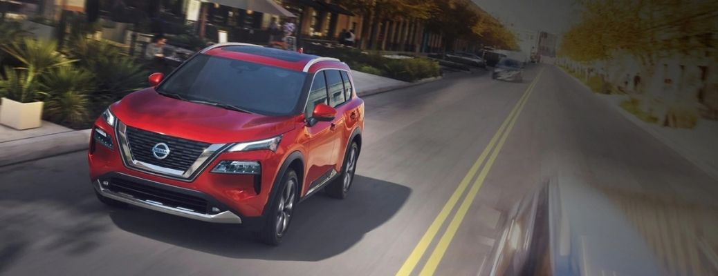 Exterior view of a red 2021 Nissan Rogue