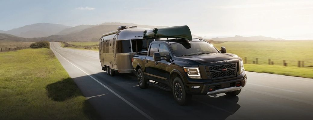 Exterior view of a 2021 NIssan TITAN towing a trailer