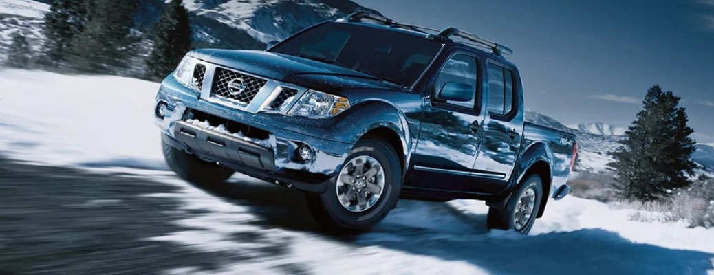 2020 Nissan Frontier driving on snow-covered road
