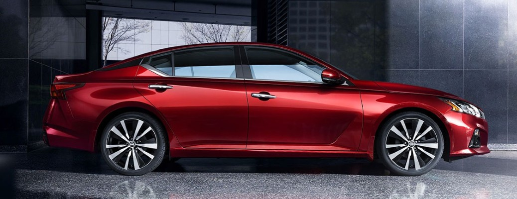 Red-colored 2021 Nissan Altima parked in an enclosed building