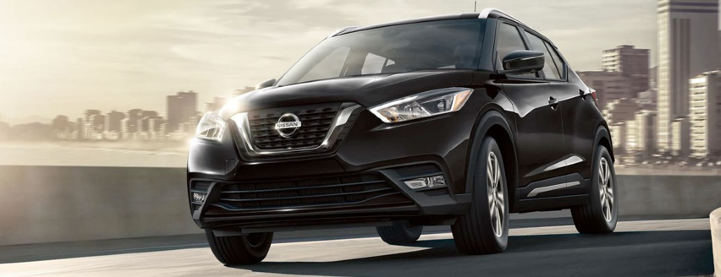 2020 Nissan Kicks driving on a road away from a big city