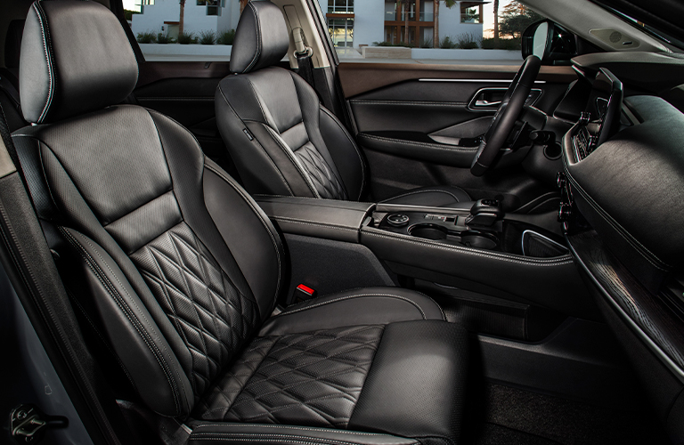 The front seats inside a 2021 Nissan Rogue