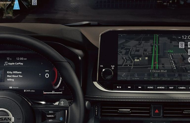 2021 Nissan Rogue infotainment screen along with steering wheel