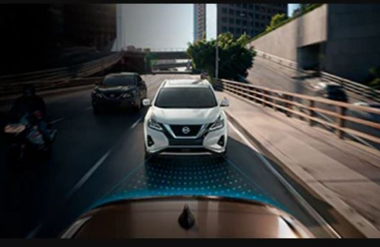 Image showing a white Nissan Murano driving behind a car on a road