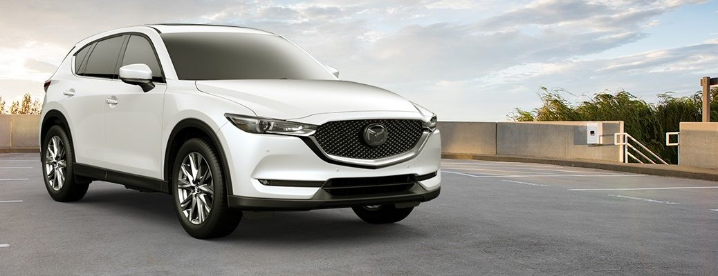 White 2019 Mazda CX-5 positioned in parking lot