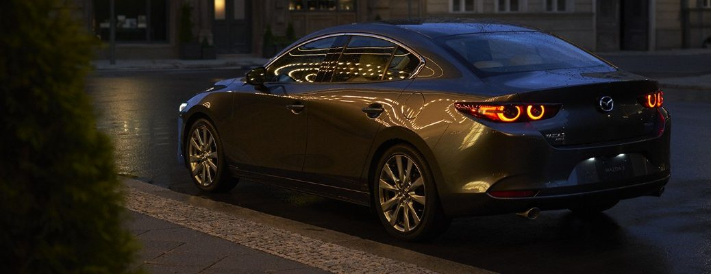 2019 Mazda3 parked on city curb at night