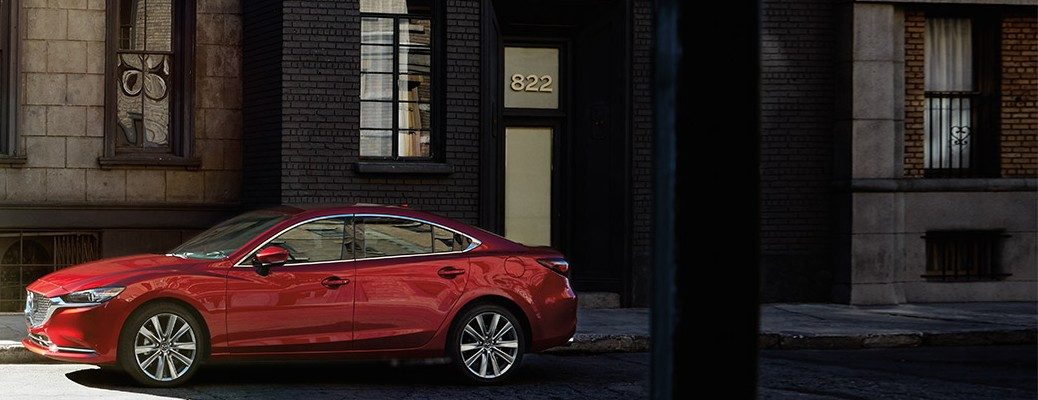 Red 2019 Mazda6 parked on city curb