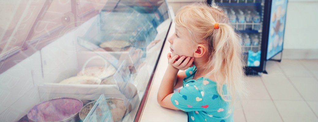Young girl looking at selection in ice cream shop
