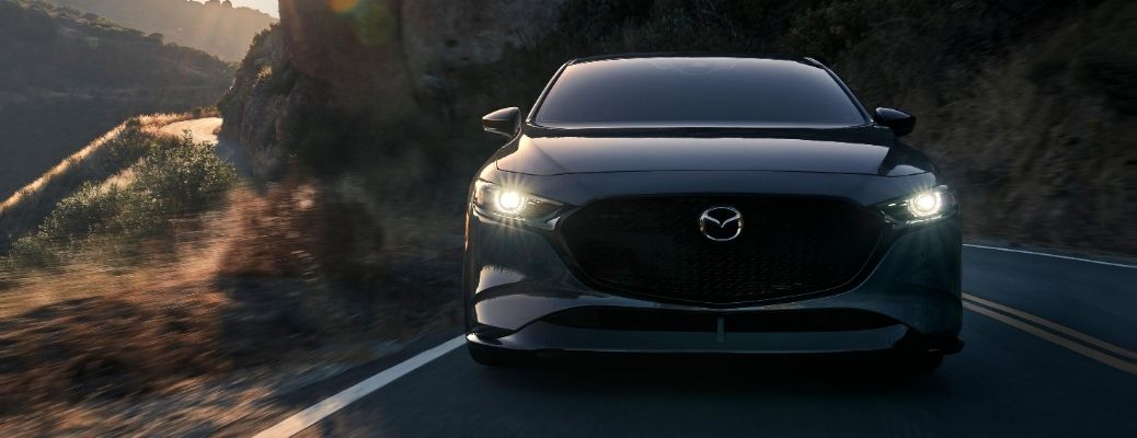 Exterior view of the front of a gray 2021 Mazda3 Turbo model