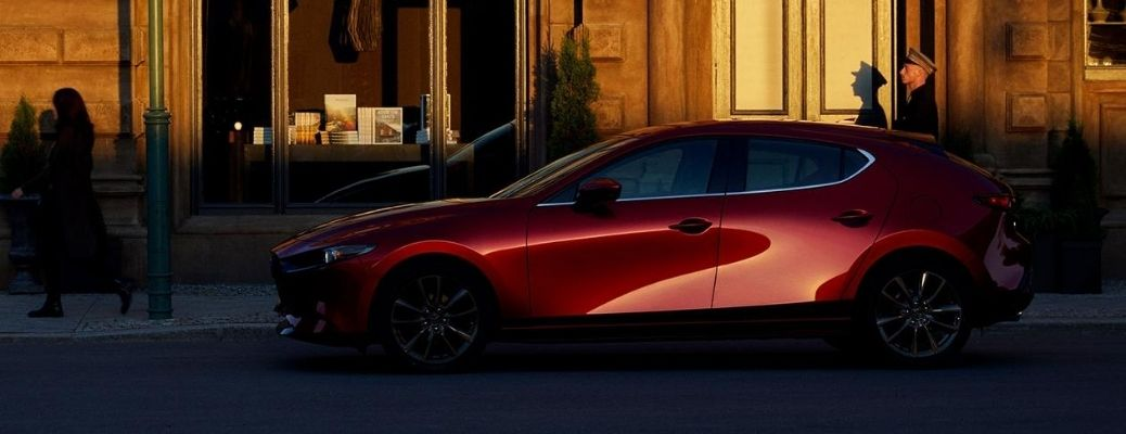 Exterior view of a red 2021 Mazda3 Hatchback
