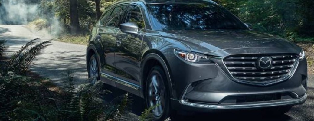 2021 Mazda CX-9 driving down road near trees