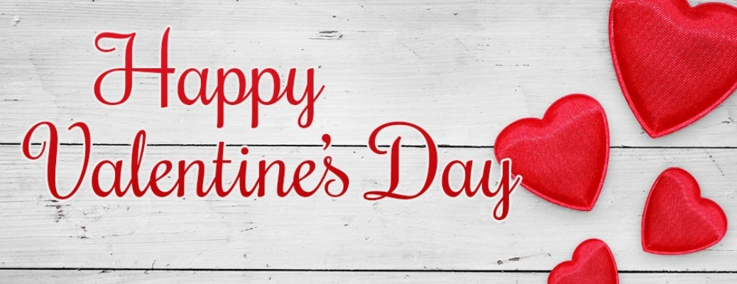 Happy Valentine's Day with four red hearts