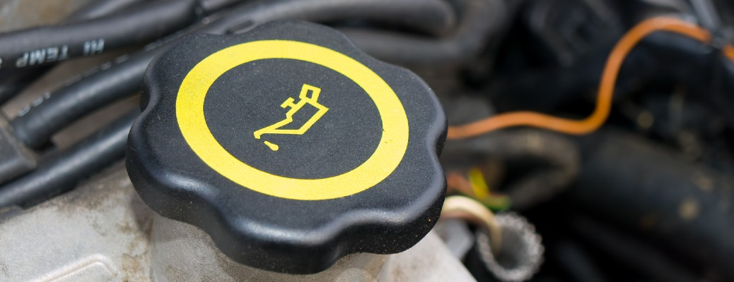 An oil cap in a vehicle under the hood