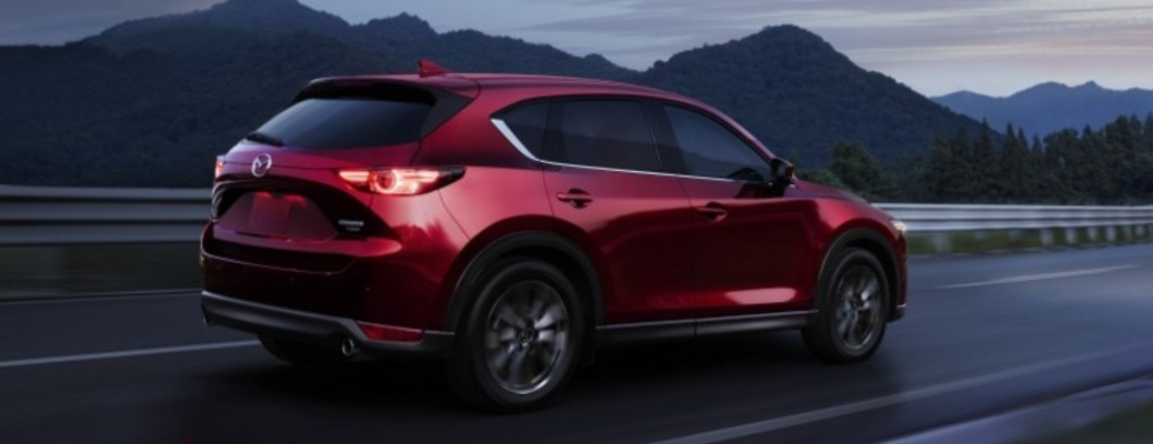 A 2021 Mazda CX-5 driving on a road