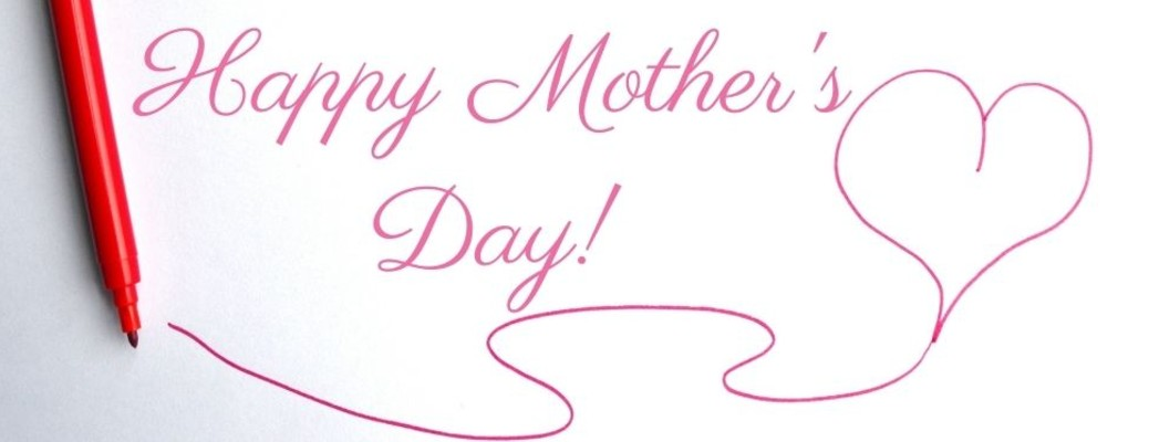 A red pen that wrote out Happy Mother's Day! with a heart next to the writing
