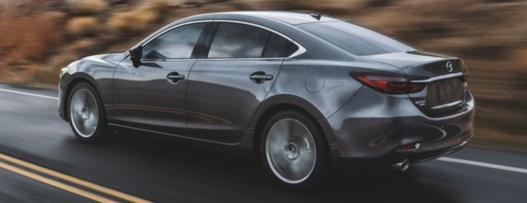 A 2021 Mazda6 driving on a road