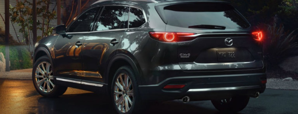 The 2021 Mazda CX-9 driving on a road at night