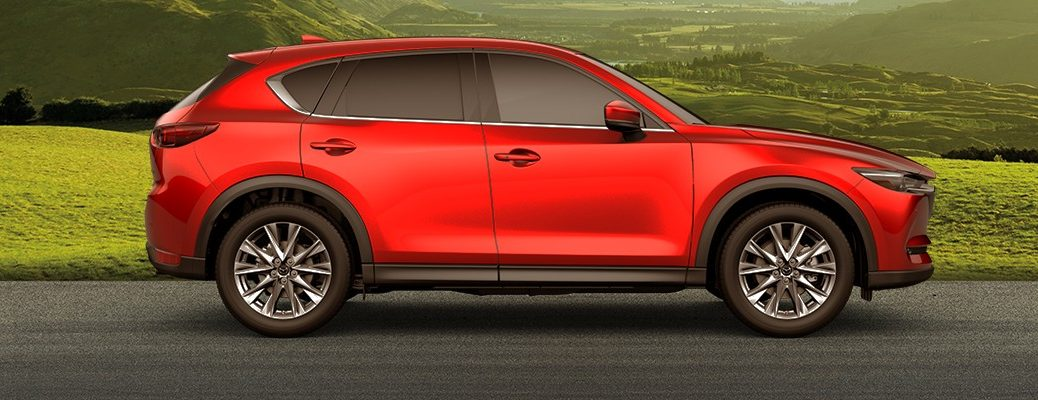Profile view of 2019 Mazda CX-5 driving on country road