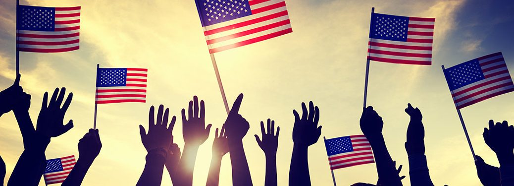 Groups of hands holding American flags