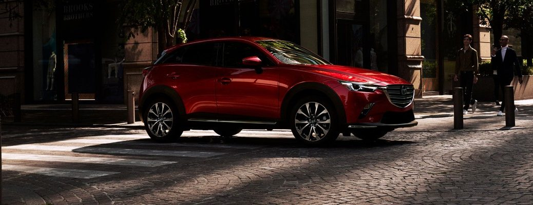 Red 2019 Mazda CX-3 parked on city street