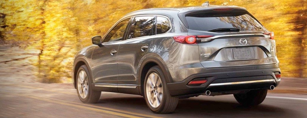 Rear view of 2019 Mazda CX-9 driving on autumn road