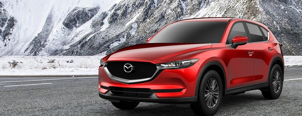 Red 2019 Mazda CX-5 Sport in front of mountains
