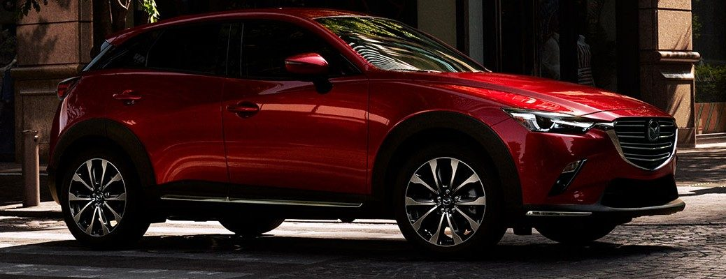 Red 2019 Mazda CX-3 parked on city curb