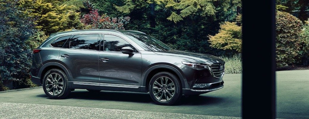 Profile view of silver 2020 Mazda CX-9 in parking lot