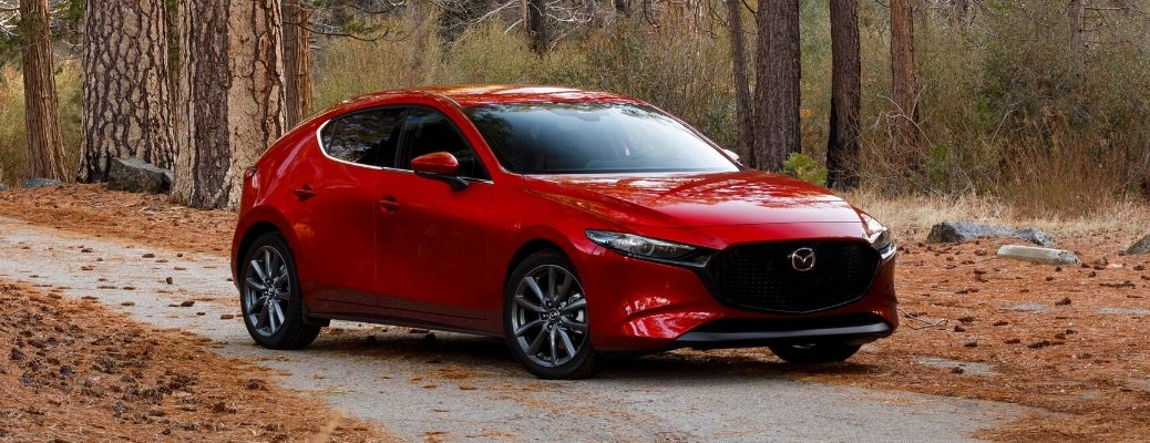 Exterior view of a red 2020 Mazda3 Hatchback