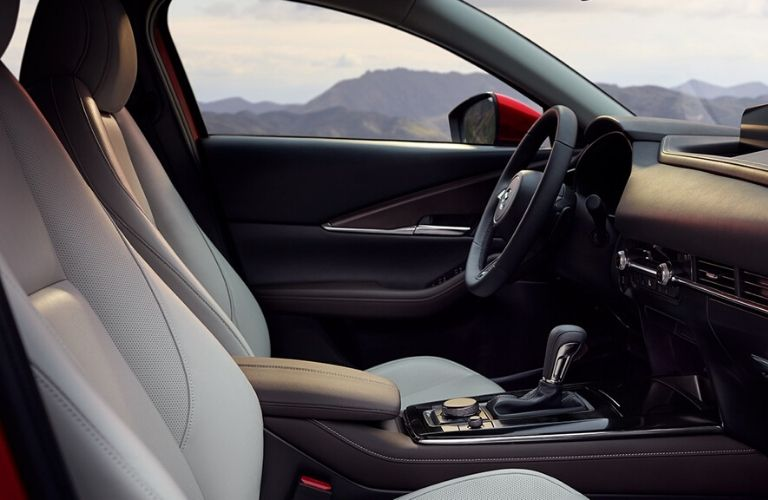 Interior view of the front seating area inside a 2020 Mazda CX-30