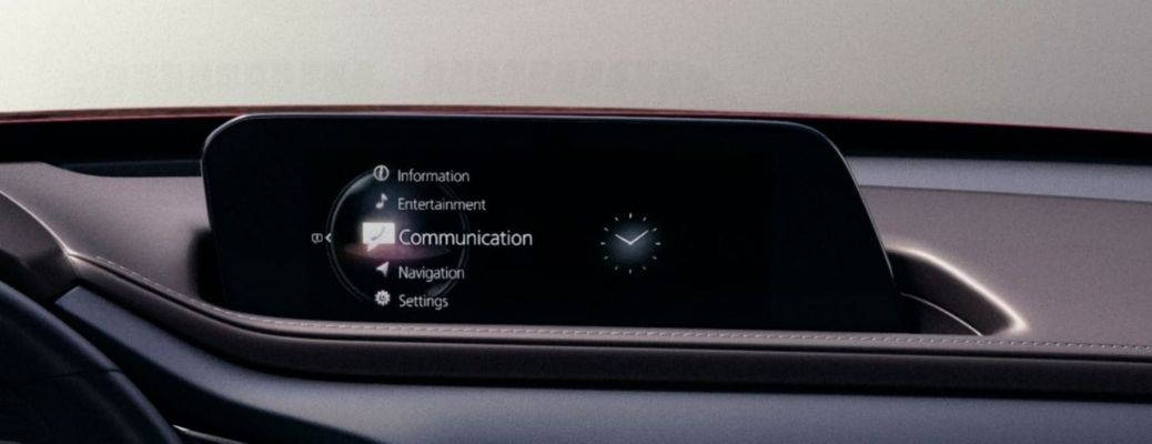 Image of a Mazda Connected Services touchscreen display inside a Mazda vehicle