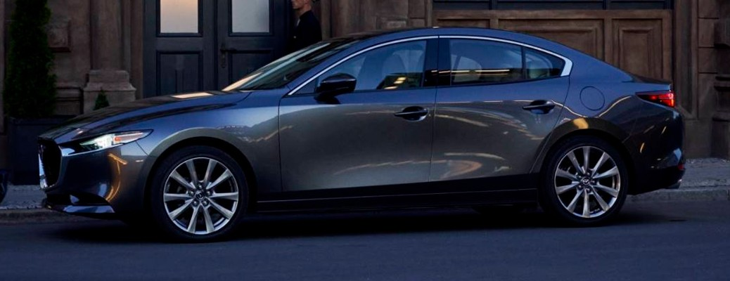A 2021 Mazda3 parked on the side of a road