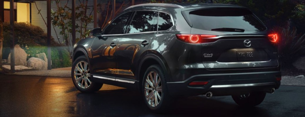 A 2021 Mazda CX-9 parked outside a home at night